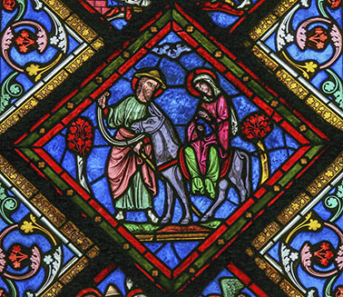 Stained glass window depicting Joseph, Mother Mary and Jesus in the cathedral of Caen, France, on February 12, 2013. This window was created more than 100 years ago, no property release is required.